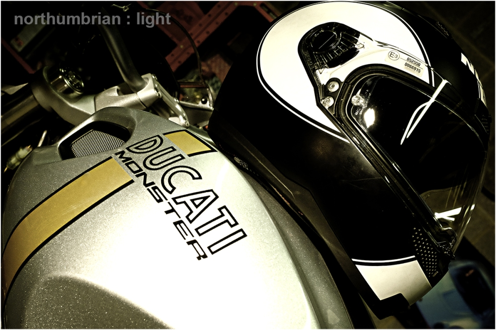 ... helmet atop Ducati Monster